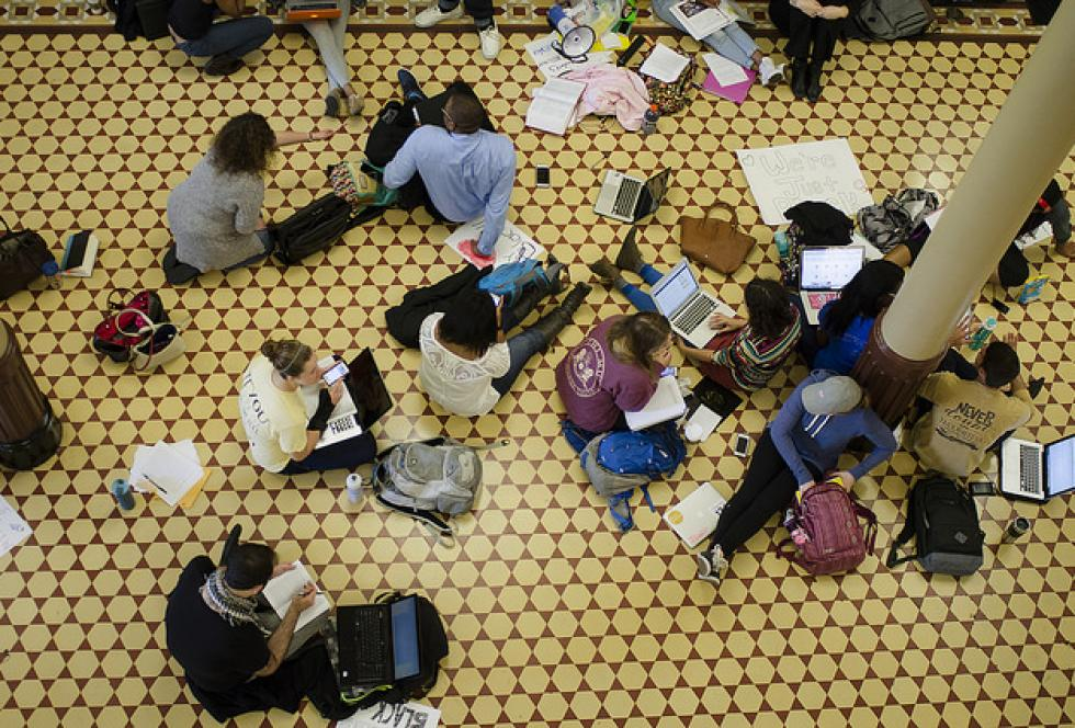 "Students study in the middle of Jesse Hall at the University of Missouri in Columbia, Missouri, during the Black Lives Matter Study Hall in support of the Black Lives Matter movement on Oct. 6, 2015. The event's mantra was ""racism lives here, and so do we."" (Flickr/Mikala Compton for KOMUnews)"
