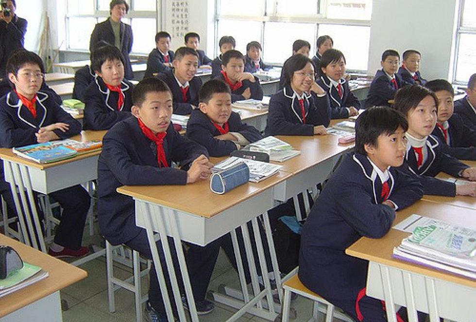 "Chinese students in the classroom. The country's education officials are trying to increase the ranks of its male teacher workforce with an eye toward developing more ""manly"" qualities among boy students. (Flickr/Mike Hetherington via Creative Commons)"