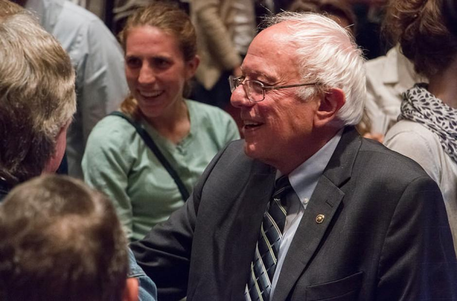 Vermont Sen. Bernie Sanders talks with Iowa voters. The youth vote played a part in his virtual  tie with Secretary Hillary Clinton in the state's Democratic caucus, experts say. (Flickr/iprimages)
