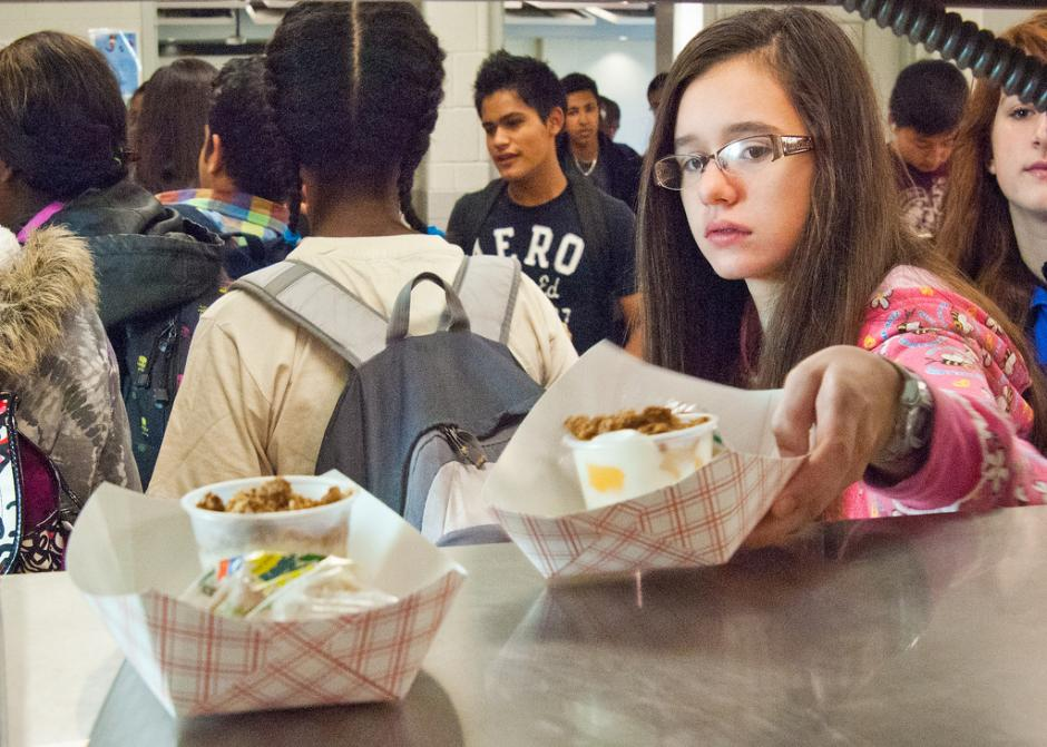Students at Washington-Lee High School, part of Arlington Public Schools, are served meals as part of the National School Lunch Program. New federal regulations set stricter standards for nutritional content. (Flickr/U.S. Department of Agriculture)