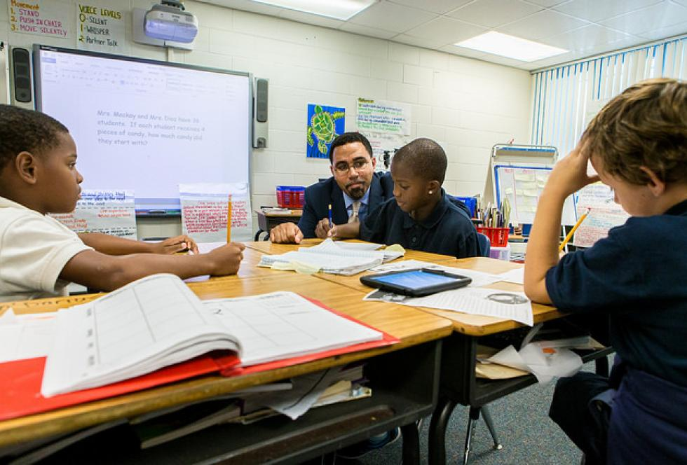 Acting U.S. Secretary of Education John King visits a classroom in Tampa, Fla. The federal Education Department's reach has been scaled back by the new Every Student Succeeds Act, as Congress sought to transfer more authority over local schools back to the states. (Flickr/U.S. Department of Education)
