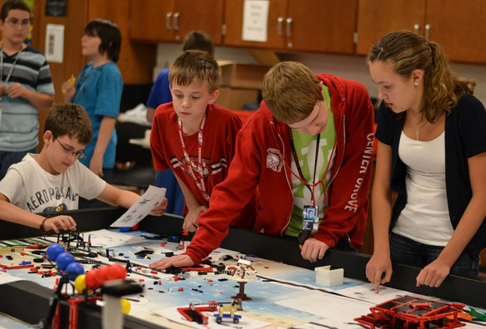 "Students work on robotics projects as part of the LEGO Education program, one approach to a ""deeper learning"" mindset in classroom instruction. (Flickr/Jeff Peterson)"