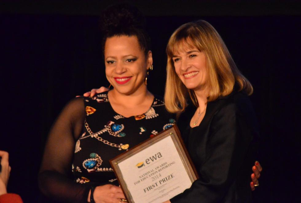 Nikole Hannah-Jones, left, receives the Fred M. Hechinger Grand Prize, from EWA executive director Caroline Hendire in Chicago on April 20, 2015. (EWA/Mikhail Zinshteyn)