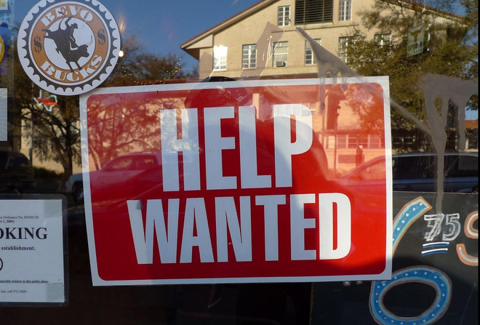 photo of help wanted sign in window