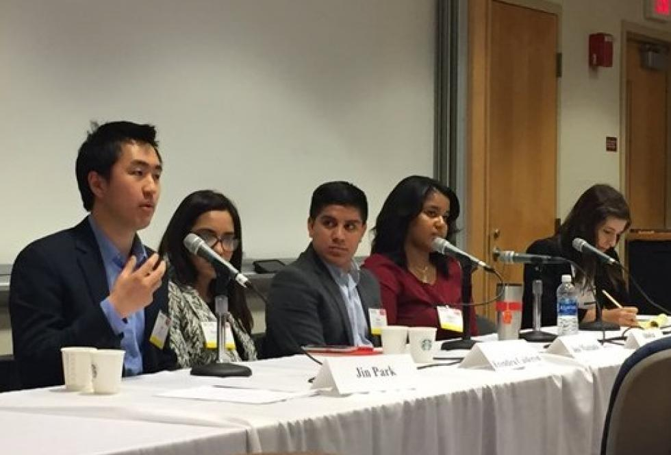 "Harvard sophomore Jin Park talks about his experiences as an undocumented immigrant student during the panel ""Interviewing DREAMers"" at EWA's National Seminar in Boston. He was joined by, from left, Erendira Calderon, Jose Machado, Ainslya Charlton, and moderator Christine Armario of The Associated Press. Source: Natalie Gross/ EWA"