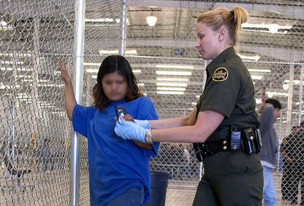 A child from Mexico is evaluated by a border patrol agent in an immigrant holding facility. Source: Gerald L. Nino/ Wikimedia Commons
