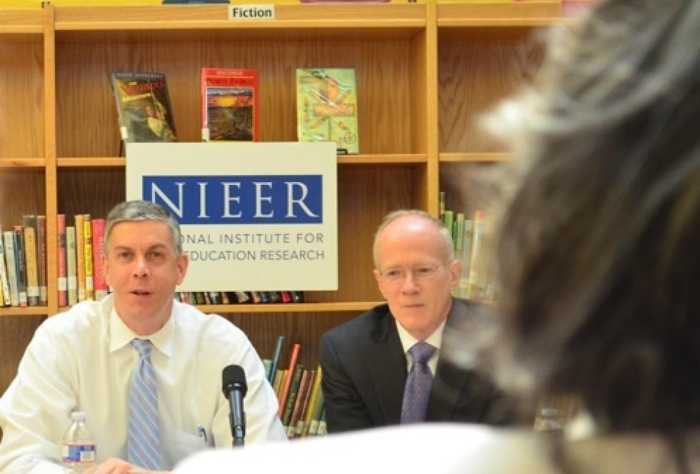 Sec. of Education Arne Duncan takes questions with National Institute for Early Education Research Co-Director Steven Barnett at the library of Bancroft Elementary School in Washington, D.C. (Photo credit: Mikhail Zinshteyn)