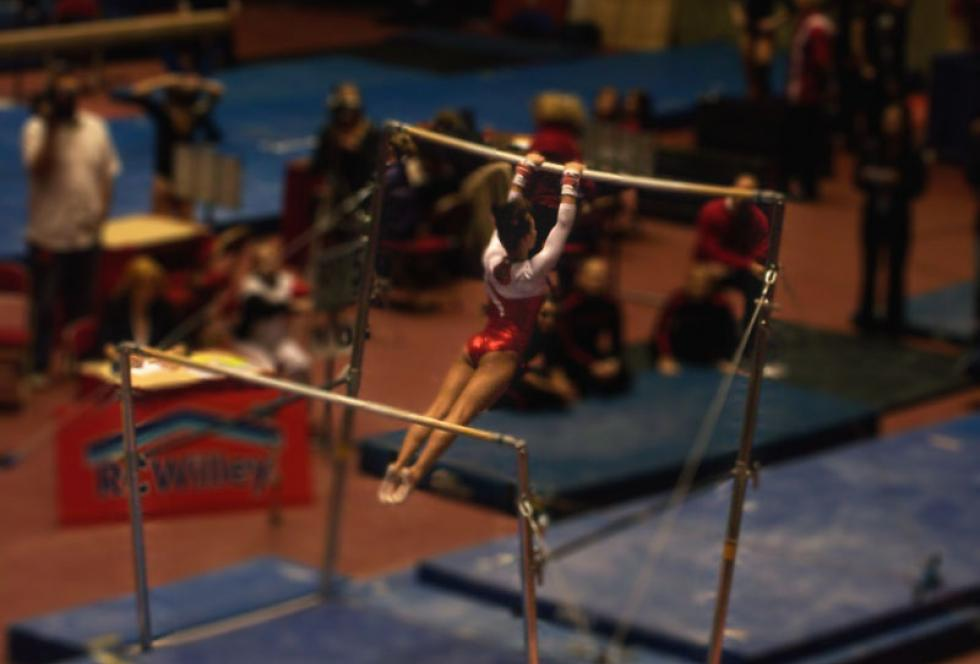 Kristina Baskett competes on bars, University of Utah Women's Gymnastics. (Flickr/lemonjenny)
