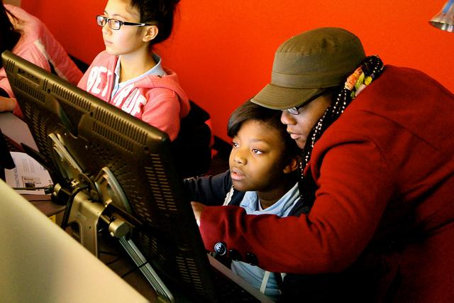 Students participate in an Hour of Code event at DePaul University, organized by the Chicago-based Digital Youth Network. (Photo credit: DYN)