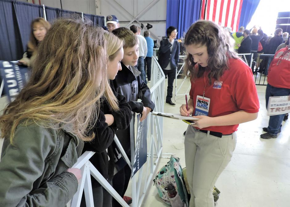 Fifteen-year-old Kid Reporter Kyra O'Connor interviews students at a rally for Republican presidential candidate Donald Trump in Columbus, Ohio. (Photo: Scholastic News)