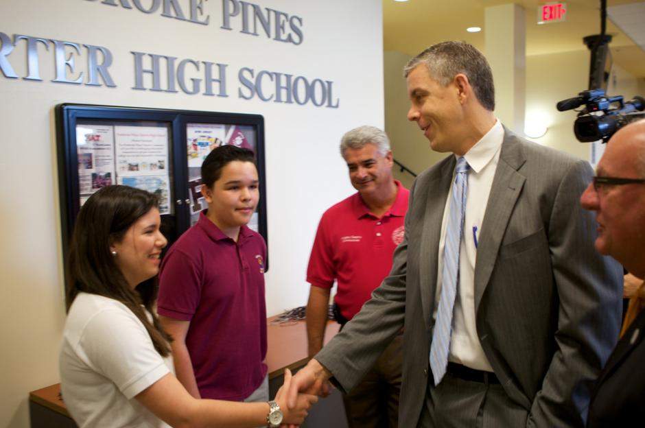 U.S. Secretary of Education Arne Duncan visits  Pembroke Pines Charter High School in Florida in 2012. Some policy analysts contend the bar for authorizing new charter schools is set too low in the Sunshine State as well as Arizona. (Flickr/U.S. Department of Education)