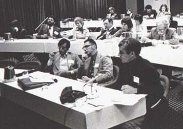 "EWA members take notes at a session called ""Who's Really in Charge of the Public Schools"" at EWA's 1978 National Seminar in Washington. Current EWA board member and former vice president John Merrow moderated the session, which was taped for broadcast on National Public Radio. 1974-76 EWA President Jack Kennedy of the Wichita Eagle is n the middle, front row.  Is that New York Times reporter Gene Maeroff second from left in the second row?"