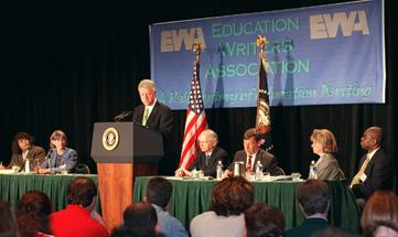 President Bill Clinton gives the keynote address at EWA's 2000 National Seminar in Atlanta. From left, EWA 1999-2000  Board Officers - Vice President Robin Farmer of the Richmond Times Dispatch, President Kit Lively of the Chronicle of Higher Education, Clinton, U.S. Secretary of Education Richard Riley,  Immediate Past President Bill Graves of the Oregonian, Secretary Joan Richardson of the Detroit Free Press and Board member Steve Henderson of the Baltimore Sun.