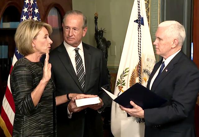 Betsy DeVos takes the oath of office.
