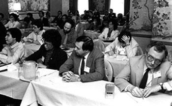 "Participants at EWA's 1983 National Seminar at the Sir Francis Drake Hotel in San Francisco listen as members of the National Commission on Excellence in Education divulge highlights of the landmark report, ""A Nation at Risk,"" almost three weeks before the official release.  1981-82 EWA President David Bednarek of the Milwaukee Journal is on the far right, front row."