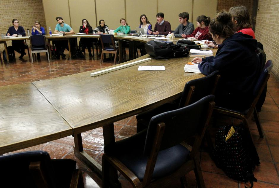 "University of Dallas students participate in a discussion of ""The Scarlet Letter"" in an American literature class that limits the size for a more challenging environment. The small Catholic school in Irving gives nearly every freshman a grant or scholarship — or both. (Mona Reeder/Courtesy: Dallas Morning News)"