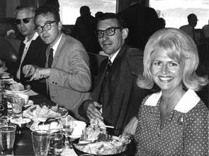 EWA 1959-1960 President Peter Janssen of the National Observer, third from left, and EWA's 1977-1978 President Bette Orsini, of the St. Petersburg Times, attend an EWA luncheon at Kennedy Space Center in Florida.