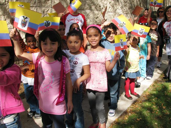 Elementary students in Illinois participate in a Parade of Nations at their school in honor of Hispanic Heritage Month. 