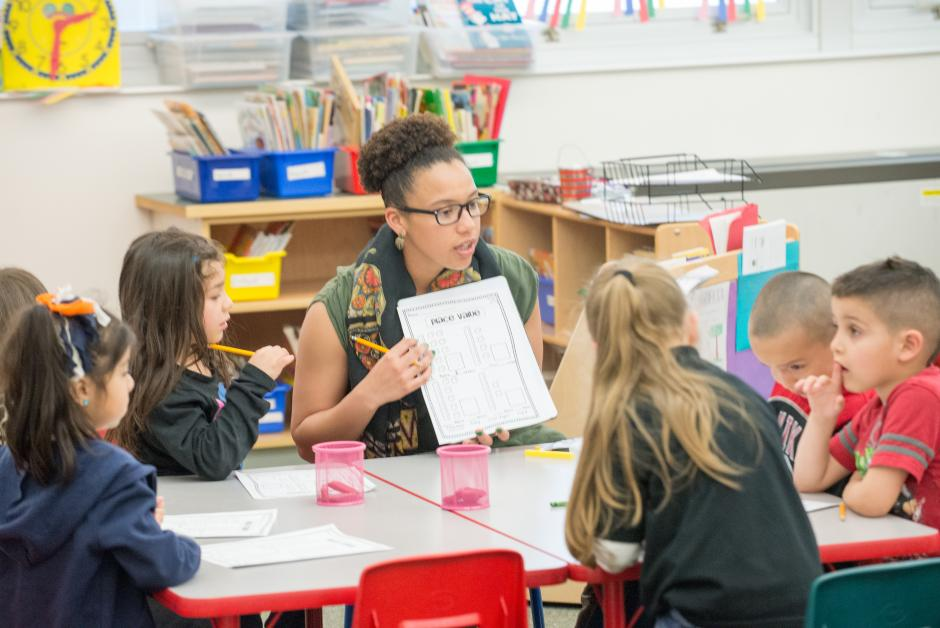 A new teacher in a Denver, Colo. classroom. With fewer young people pursuing teaching careers, the Mile High City is one of a growing number of communities using residency programs to recruit and support new teachers. (Urban Teacher Residency United)