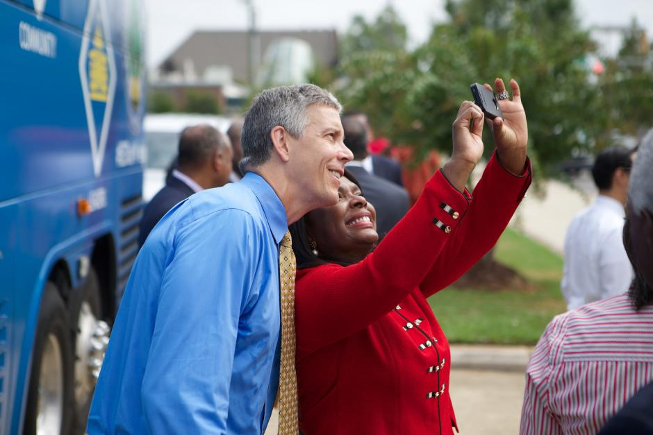 U.S. Secretary of Education Arne Duncan poses with a fan in Birmingham, Alabama during the 2014 back-to-school bus tour. This year's tour runs this week. (Flickr/U.S. Department of Education)