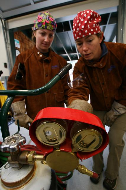 A student and teacher in a welding class. A new study of Arkansas high schoolers found girls were more likely than their male classmates to specialize in a particular area of career and technical education. (Flickr/Photo Dudes)