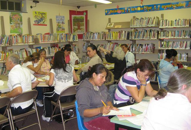Adults meet at the English Club for English Language Learners at the Rockaway Township Free Public Library in New Jersey. 