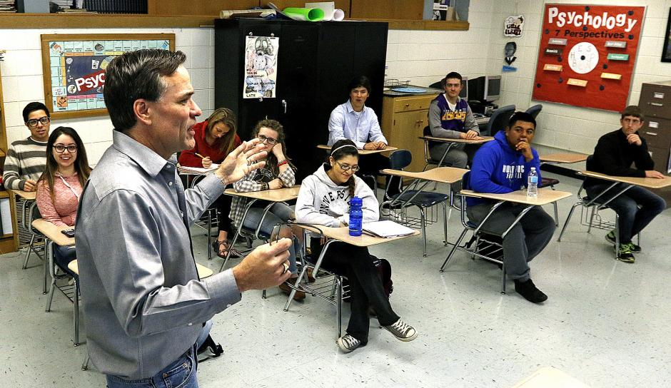 Woodstock High School psychology teacher John Headley leads an Advanced Placement class discussion on classical and operant conditions. Woodstock District 200 in Crystal Lake, Illinois has been working with the nonprofit Equal Opportunity Schools to be proactive about allowing more students to access AP courses. (H. Rick Bamman / Shaw Media)