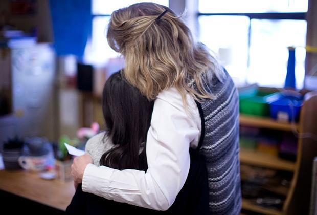 image from the Oregonian of teacher and student in classroom