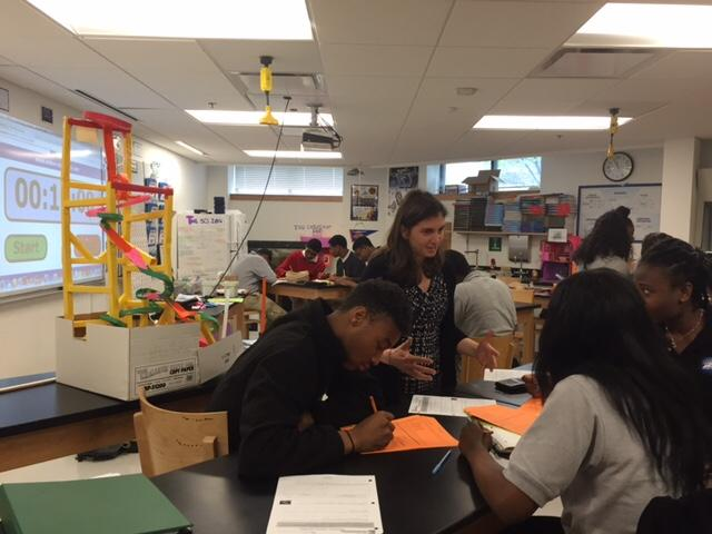 Physics teacher Maggie Mahmood works with sophomore students at Codman Academy Charter Public School in Dorchester, Mass. (Liana Heitin for EWA)