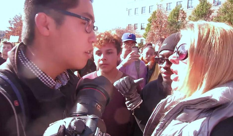 Tim Tai, a student photographer on assignment for ESPN,  films in a public area, and student activist groups confront him. (Wikipedia/Screen capture from video by Mark Schierbecker)