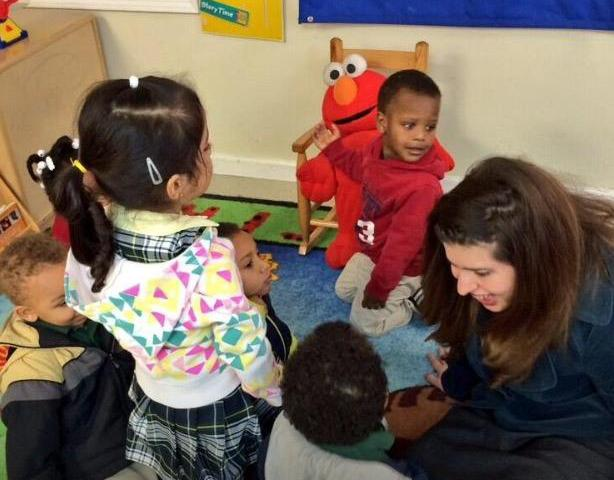 Huffington Post education reporter Joy Resmovits talks with children at a New Orleans preschool during an EWA site visit in February 2014. (EWA/Emily Richmond)