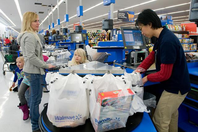 A cashier bags items in Gladstone, Missouri. It's not unusual for teachers to take part-time jobs like these to boost their retirement savings. (Creative Commons/Walmart)