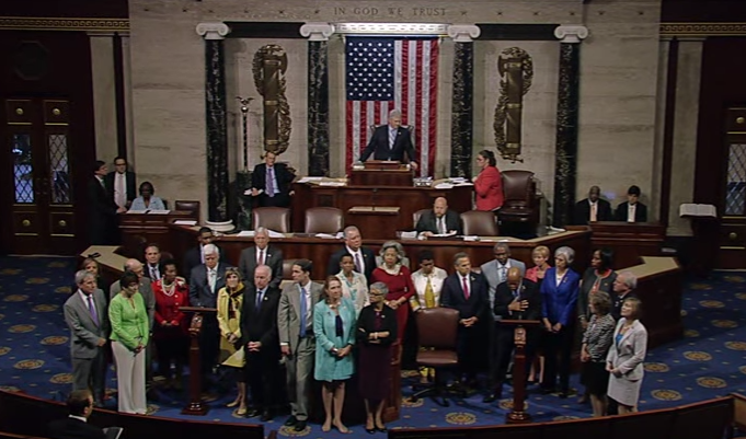 Democrats stand on the floor of the U.S. House of Representatives during a sit-in to protest in inaction by Congress on gun control legislation. (Wikimedia/U.S. Congress)