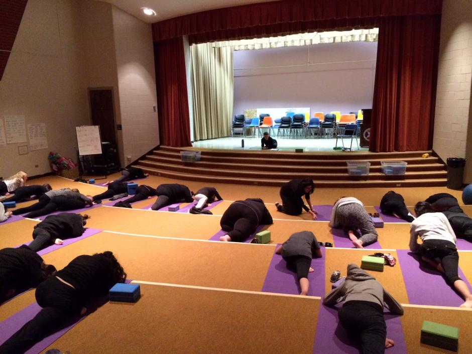 Students at the Girls Athletic Leadership School, a Denver charter campus, begin their day with yoga. School leaders say transportation issues pose a significant hurdle for prospective families. (EWA/Emily Richmond)